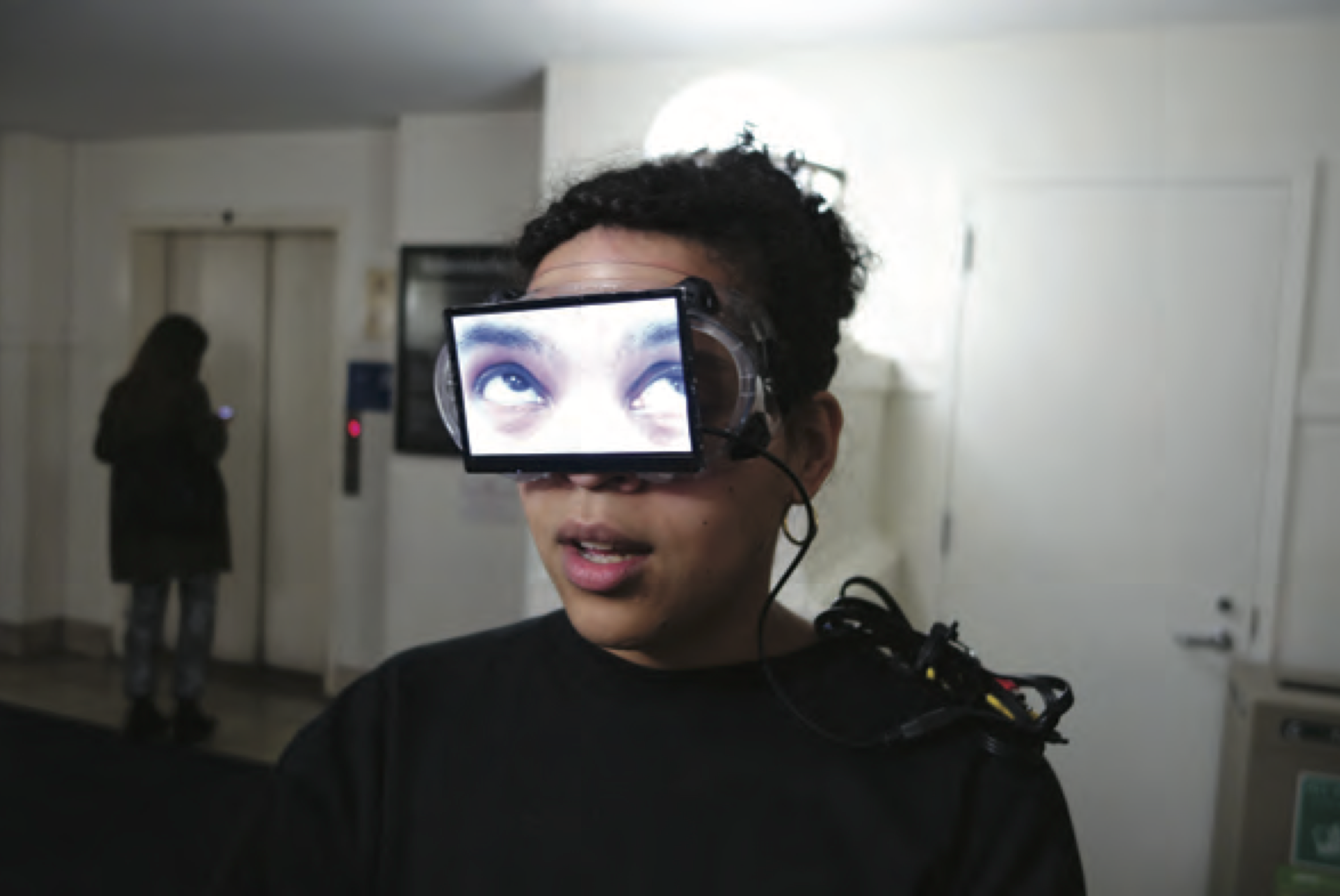 Interdisciplinary artist Sondra Perry combines video, computer-based media, and performance in Young Women Sitting and Standing And Talking and Stuff