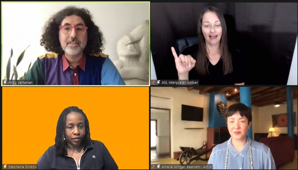 Screen grab of Zoom webinar with four pinned participants. Hrag Vartanian in the top left square with a background of a white wall, plant in background on left and sculpture on right. ASL Interpreter Amber in the top right square with black background. Stephanie Dinkins in the bottom left square with a bright orange background. Amelia Winger-Bearskin in the bottom right square with a living room background featuring couch, blue pillars and TV on wall.